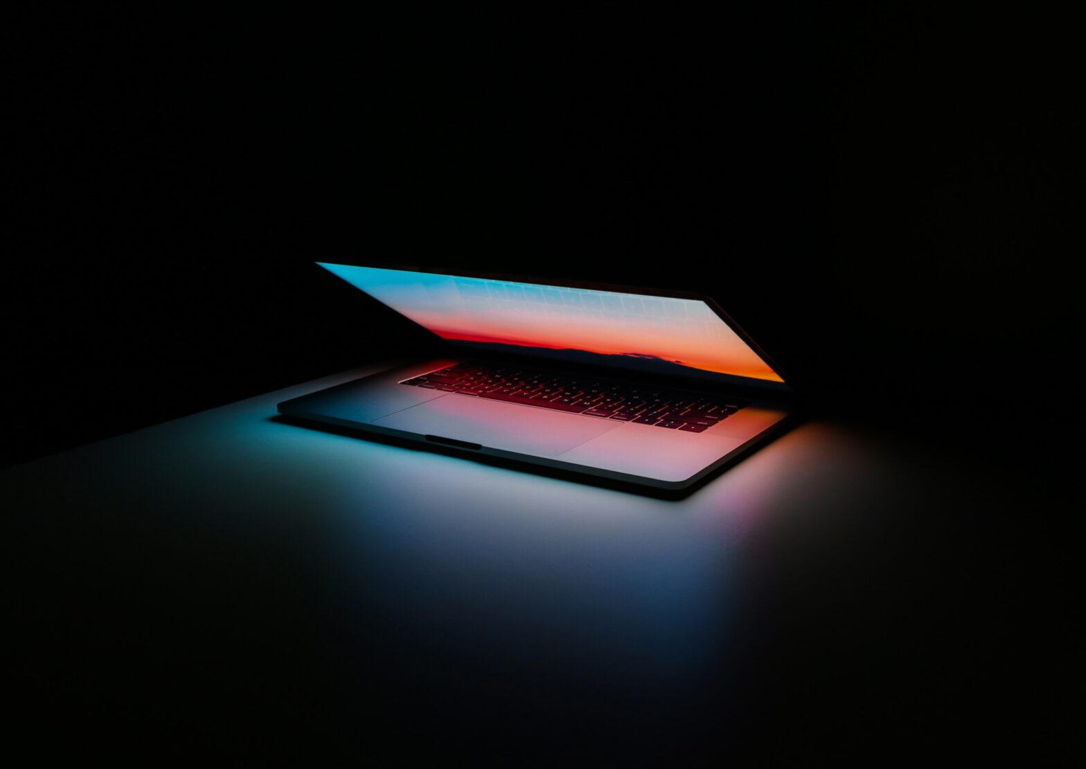 supply chain computer glowing in dark room